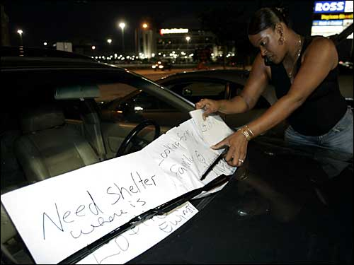 Sign on car: Need shelter