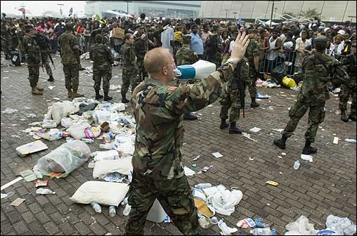 Louisiana Army National Guardsman Ed Bush pleaded for evacuees to stop pushing forward during relief efforts at the Superdome Thursday.