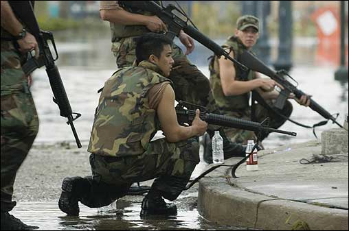 The Louisiana Army National Guard took position while providing security for evacuees during aftermath relief efforts Thursday in New Orleans.