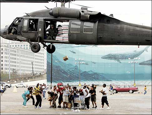 A military helicopter made a food and water drop to flood victims near the Convention Center in New Orleans Thursday.