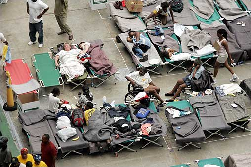 Refugees began filling up cots on the floor of the Astrodome Thursday. The Astrodome, which quickly filled, was the planned destination for many evacuees.