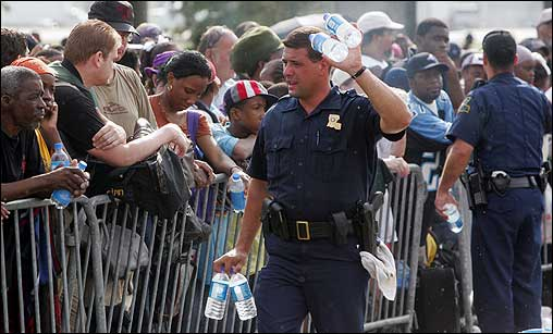 Louisiana State Troopers passed out water at the evacuation staging area in Metairie, La., on Thursday.