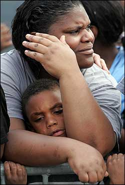 New Orleans residents Cynthia Allen and her son Anthony awaited evacuation in Metairie, La., on Thursday.