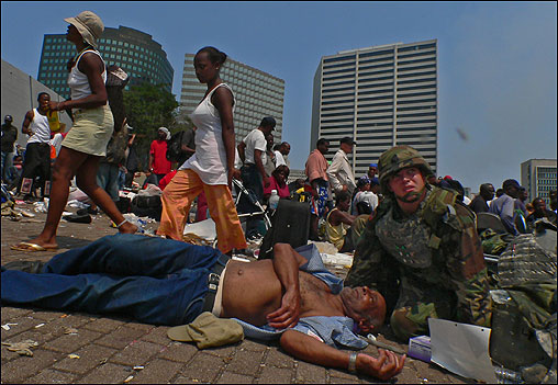 A National Guard soldier tended to a man on the street in front of the New Orleans Convention Center Friday.