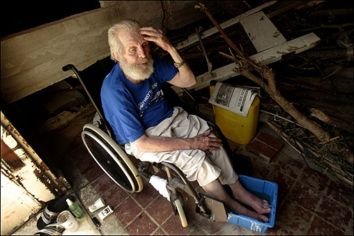 William Travis, 82, took refuge in an abandoned building in Biloxi, Miss. He said he needed medical attention and was waiting for help to arrive. He had been sleeping in his wheelchair for two nights.