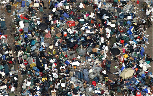 Exhausted refugees patiently waited at the Superdome in lines for their place on a bus.