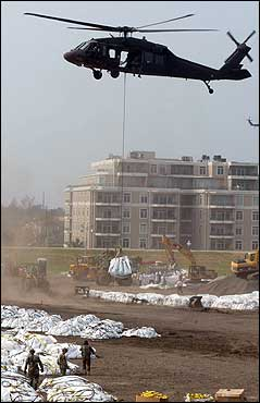 A blackhawk helicopter lifted a 3,000 pound bag of crushed limestone to transport to one of three areas of the levee system around New Orleans that was being repaired Monday. The US Army Corps of Engineers closed a major gap in a key levee Monday and began pumping water out of the city, one week after the hurricane hit.