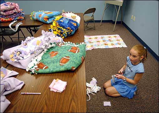 Emma Abel, 10, made blankets at First United Methodist Church in Mount Vernon, Ind., Monday for children of families evacuated because of Hurricane Katrina. Members of the church welcomed and served dinner to displaced families from Mississippi and Louisiana.