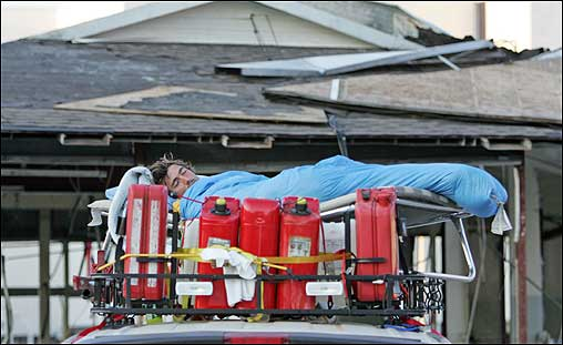 Unable to find lodging because of widespread damage in area hotels, news photographer R. J. Sangosti slept surrounded by gas cans on the roof of his car in Biloxi, Miss.