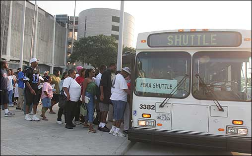 Victims of Hurricane Katrina boarded a bus bound for a FEMA disaster recovery center located in Houston at the Astrodome.