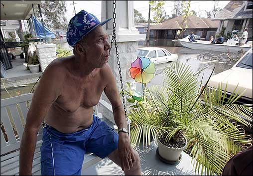 Thousands of hurricane victims have refused to leave their homes in New Orleans. While Mayor Ray Nagin has ordered forced evacuation, police have called forced removal an 'absolute last resort.' John Ebanks, who has refused to leave, sat on the porch of his home in the 9th Ward in New Orleans Monday.