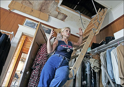 Debra Hilgeban stood on the attic ladder she clung to with her three dogs during Hurricane Katrina in Gulfport, Miss. Her house, built in 1901, survived the storm but was water-damaged nearly to the ceiling. One of her dogs was lost in the storm.