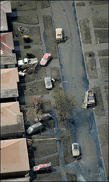 Homes and cars were covered in mud after flood waters from Hurricane Katrina receeded in St. Bernard Parish, La.