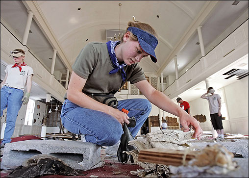 Amy Bentley of Mobile, Ala., examined a book damaged by the flood waters in the First Presbyterian Church in Gulfport, Miss. The book was from the nearby public library and floated into the church with other debris from the storm.