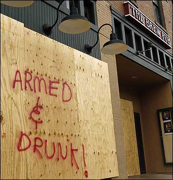 A warning was written on plywood covering to Rickenjacks Brew Pub Friday in downtown Lake Charles, La.