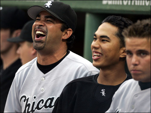 Chicago White Sox manager Ozzie Guillen laughed in the dugout during the fourth inning of Game 3.