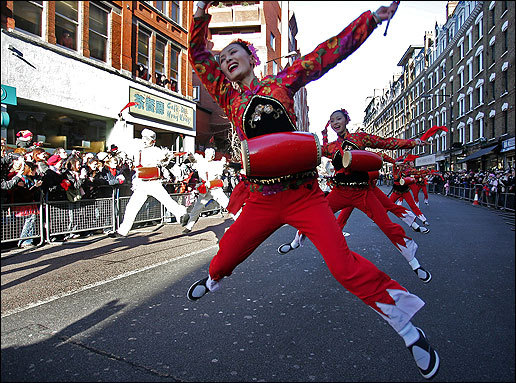 Dancers from China Shenzhen Arts Troupe dance as they parade through central London in celebration of Chinese New Year on Sunday. Tens of thousands of people packed central London to join in colourful celebrations of Chinese New Year. Huge crowds braved the cold to watch fireworks and the traditional Grand Parade of dragons and lions from Chinatown to Trafalgar Square.