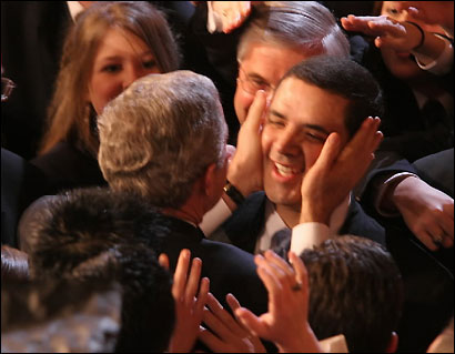 President Bush touches the face of Democrat Henry Cuellar after his State of the Union at the Capitol in Washington Wed., Feb. 1, 2006. The photo has led to a surge in online donations to Cuellar's rivals in next month's Democratic primary.