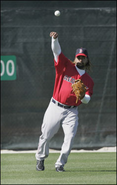 Manny throws from the outfield at spring training in Fort Myers on Wednesday.