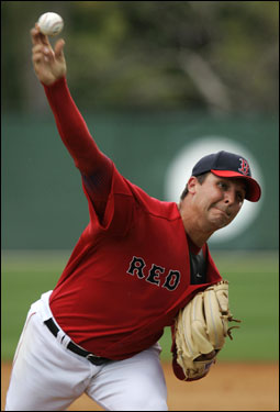 Red Sox pitcher Keith Foulke fires to the plate while facing live batters for the first time at spring training, Friday morning. Foulke, who threw just over 40 pitches, is recovering from surgery on both of his knees. He said he expects to be ready to play on Opening Day.