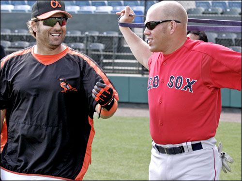 Baltimore Orioles' Kevin Millar (left) talks with Kevin Youkilis during Wednesday's pregame warmup. Millar is one of the new faces among the Orioles, and played with the Red Sox during the 2005 season.