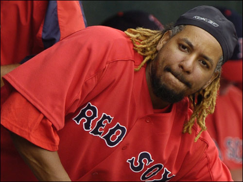 Manny Ramirez looks out of the dugout onto the crowd.