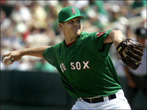 Red Sox starter Jon Papelbon, wearing green for St. Patrick's Day, delivered a throw in the second inning against the Marlins.