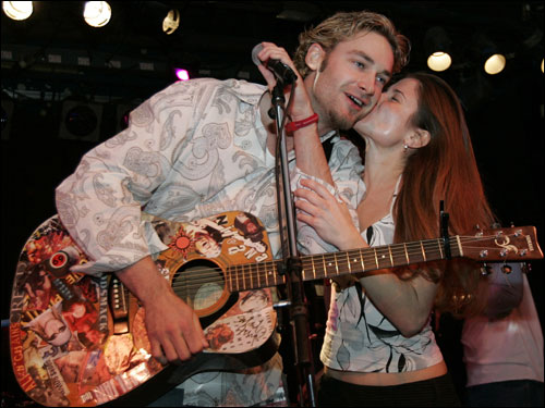 Arroyo (left) gets a kiss from an unidentified fan following his performance at the Hot Stove Cool Music benefit for the Jimmy Fund at the Paradise Rock Club in Boston, Sunday, Jan. 9, 2005.