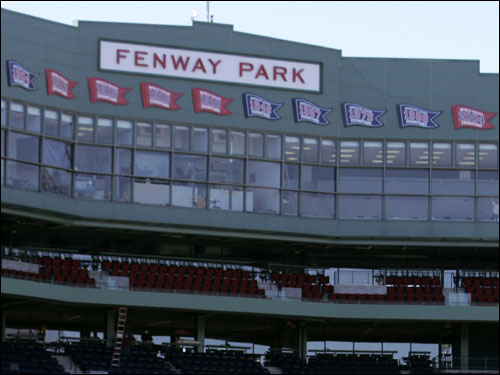 The area above the press box now displays Red Sox American League pennant and World Series banners.