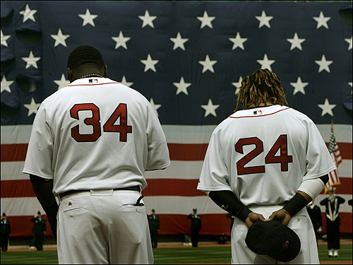 Sluggers David Ortiz, left, and Manny Ramirez stood during the national anthem.