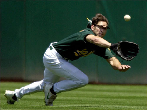 July 15, 2001 Playing for the Oakland Athletics, Damon made a diving catch of a ball hit by the Colorado Rockies' Niefi Perez in Oakland, Calif.