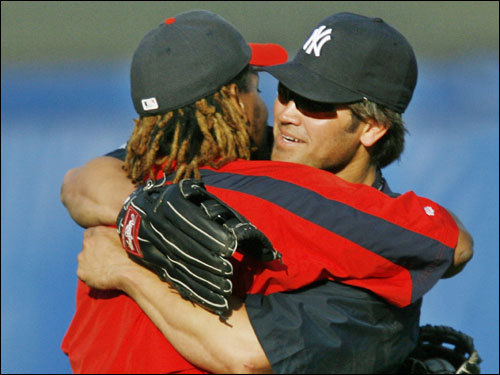 March 22, 2006 Red Sox left fielder Manny Ramirez and New York Yankees center fielder Johnny Damon embraced on the field before a spring baseball game between the the Yankees and the Red Sox at Legends Field in Tampa, Fla.