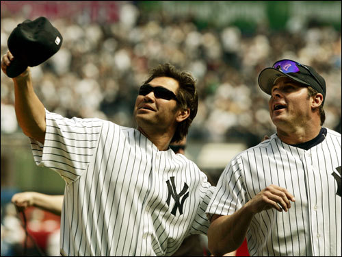 April 11, 2006 Yankees center fielder Johnny Damon, left, and first baseman Jason Giambi looked at F-14 tomcats after two of the planes made a flyover before the Yankees home opening game against the Kansas City Royals.