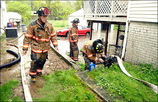 Bristol, Conn., firefighters pumped water from the basement of a home. Several city roads were closed and multiple basements were flooded with some parts of the state receiving close to 4 inches of rain on Friday.