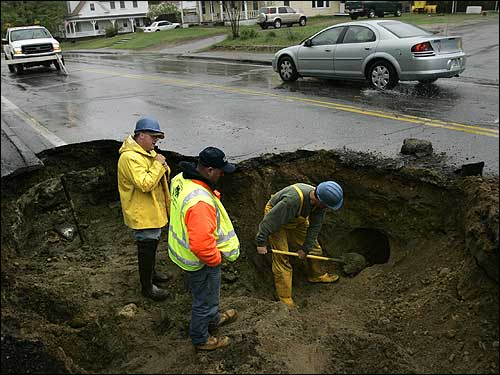 workers check utility lines