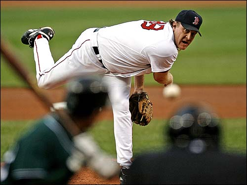 Curt Schilling delivers a pitch to Tampa Bay's Julio Lugo during the first inning. By the time the Sox got the final out, Schilling had recorded his 200th win in 392 starts and 525 games.