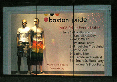 This photo provided by MassResistance shows a window display marking gay pride week and featuring two male mannequins, with one wearing a gay pride rainbow flag, at Macy's department store in downtown Boston.