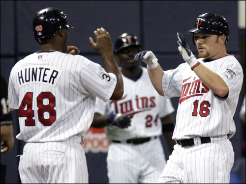 Kubel was met at home plate by teammate Torii Hunter.