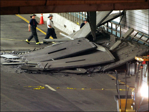 Firefighters inspected a section of ceiling in the Interstate 90 connector tunnel eastbound through Boston that collapsed onto the roadway.