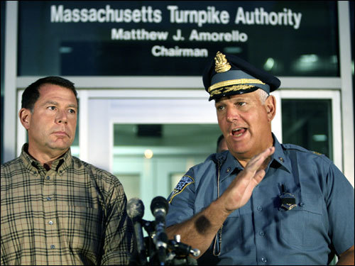 Amorello, left, listened as Massachusetts State Police Major Michael Mucci speoke at a news conference about the woman who was killed when part of the ceiling in a Big Dig tunnel fell on a car in South Boston.