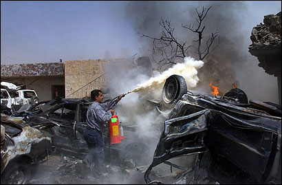 An Iraqi tried to put out a fire after a car bomb attack in Kirkuk, Iraq, yesterday. Kirkuk is at the center of the country's oil fields, which has been the subject of rival claims by Arabs, Kurds, and Turkomen.