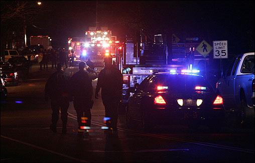 Emergency vehicles parked alongside Water Street in Danvers.