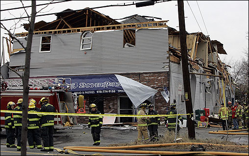 Firefighters surrounded a bakery, one of several buildings damaged in the explosion.