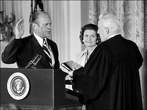 US Chief Justice Warren Burger, right, administered the oath of office to Ford as the 38th President of the United States at the White House in Washington, D.C., on Aug. 9, 1974, following Nixon's resignation. At center, Betty Ford held the Bible.