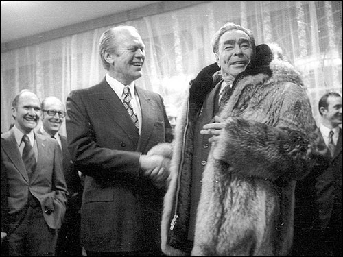 President Ford with Leonid Brezhnev in 1974 after the Soviet leader tried on Ford's fur coat in Vladivostov, just prior to the two leaders' formal meeting. The leaders reached a tentative deal at the November summit to limit the number of nuclear weapons between them.