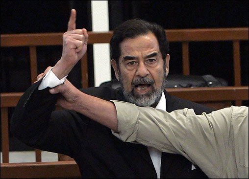A bailiff attempted to silence Saddam Hussein, who yelled at the court while the verdict of his trial was delivered in Baghdad on Nov. 5, 2006. The court sentenced Hussein to death for his role in the 1982 slayings of 148 Shi'ite Muslims from a town where assassins had tried to kill him.