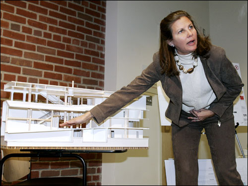 Janet Marie Smith, the Red Sox senior vice president of planning and development, points to a model while describing improvements to Fenway Park on Wednesday.