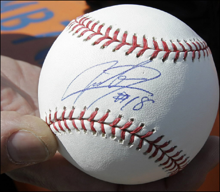 Red Sox fan Michael Ardagna, from Andover, showed a baseball that Daisuke Matsuzaka autographed for him near the Red Sox player development complex in Fort Myers on Wednesday.