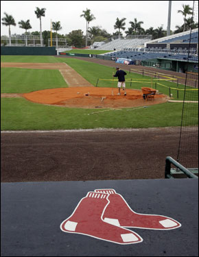 A grounds crew member worked around home plate at City of Palms Park in Fort Myers.