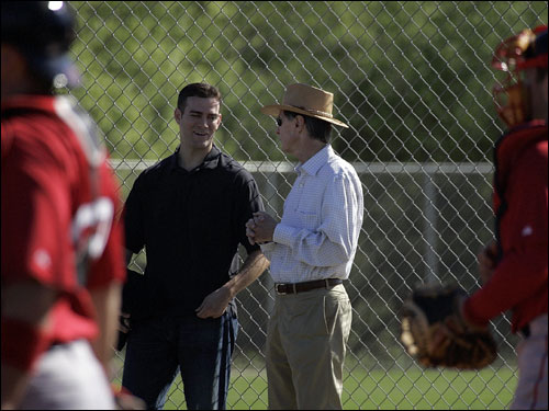 Red Sox GM Theo Epstein (left) and principal owner John Henry watched the bullpen at the team's player development complex in Fort Myers on Tuesday.